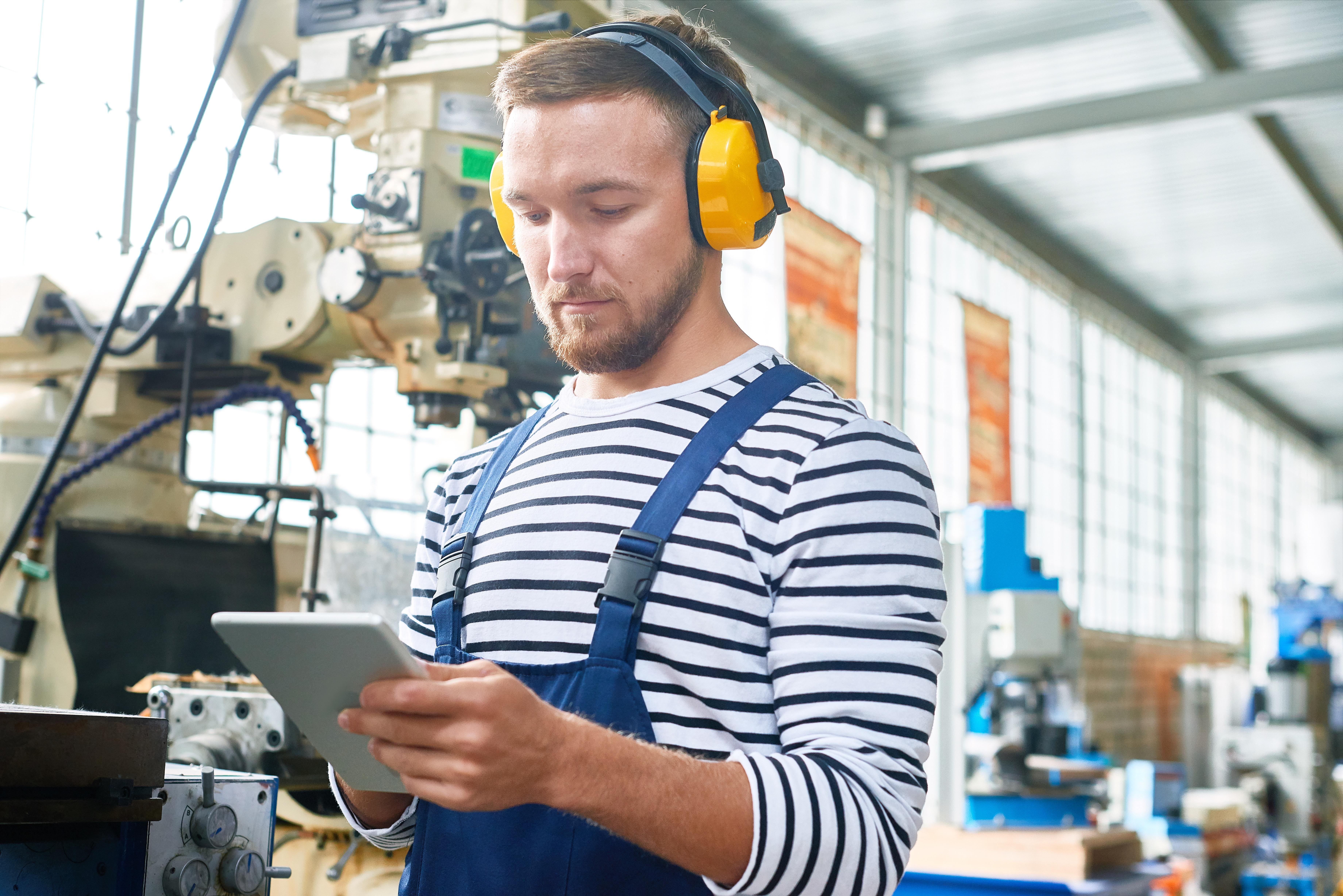 factory worker on tablet.jpg