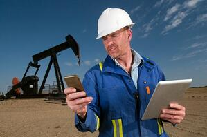 A oil and gas industry worker leverages digital technology out in the field.