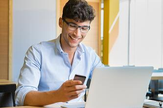 happy business man with phone-2